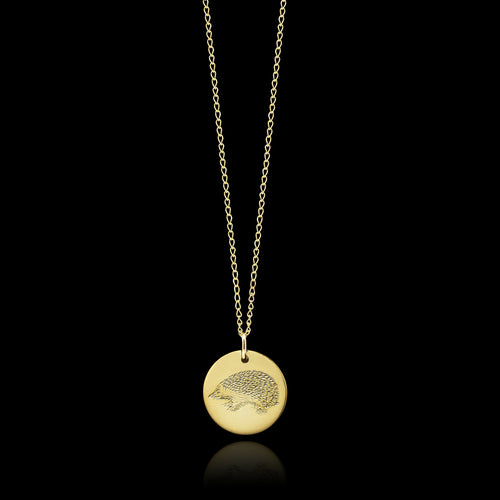 Gold Hedgehog design disc necklace by Catherine Zoraida