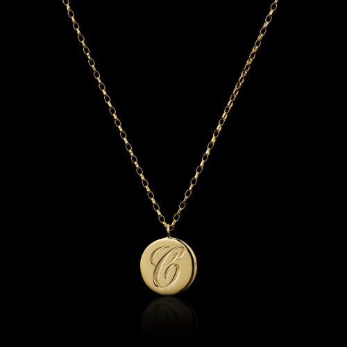 Personalised engraved initial pendants in gold by Zoraida London