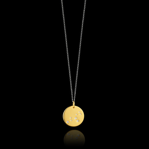 Leo Zodiac star sign pendant in gold with silver chain. Made by British jewellery designer Catherine Zoraida