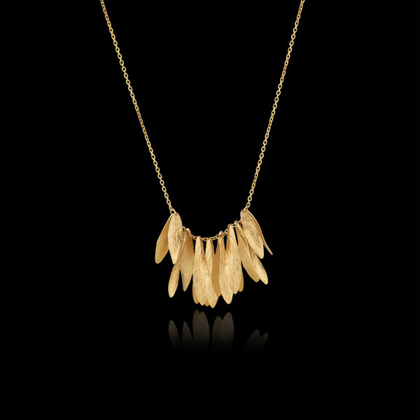 gold leafy jingle necklace by jewellery designer Catherine Zoraida