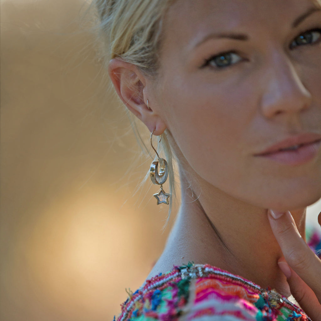 Love you till the moon and back statement earrings by Zoraida London Jewellery. Moon and Star Earrings modelled by Alice