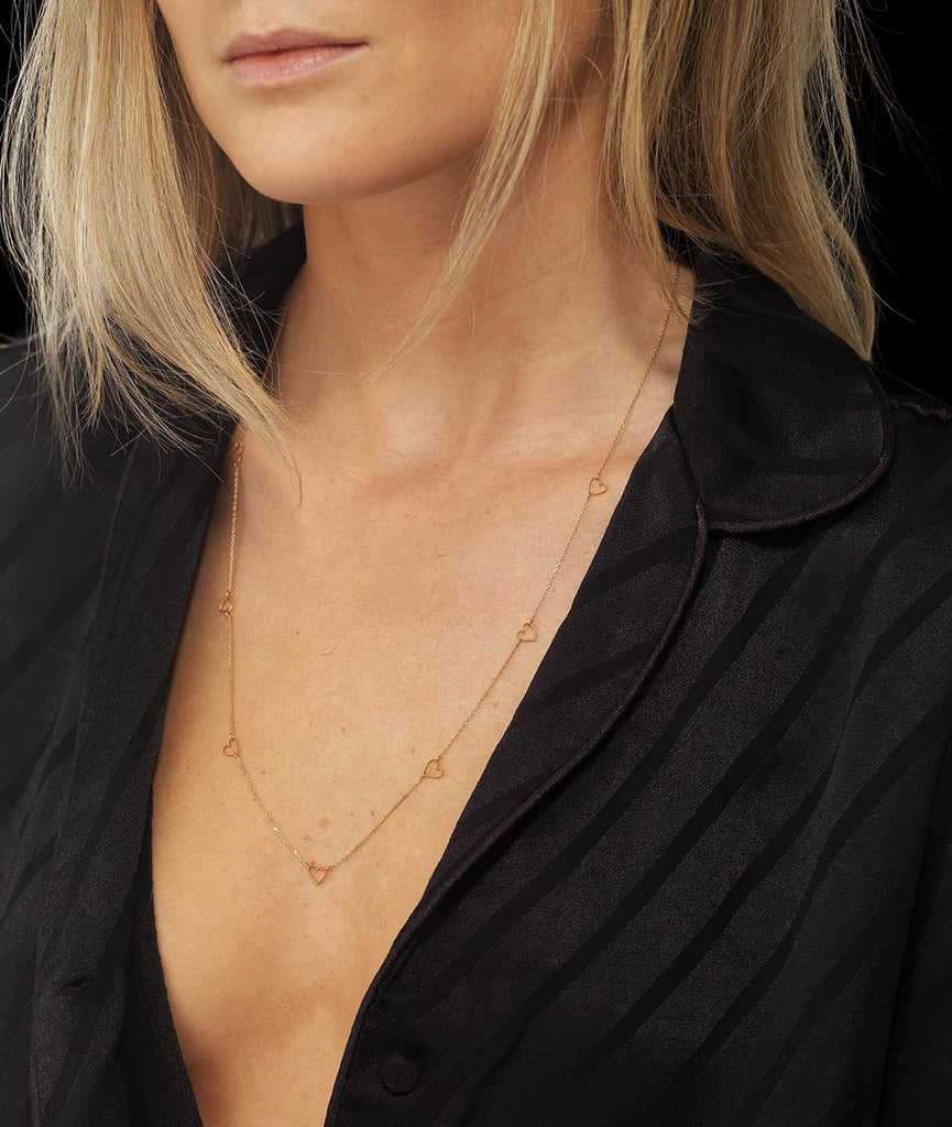 9 carat fairtrade gold Love Heart Necklace by British jewellery designer Catherine Zoraida. Model Lucy Williams