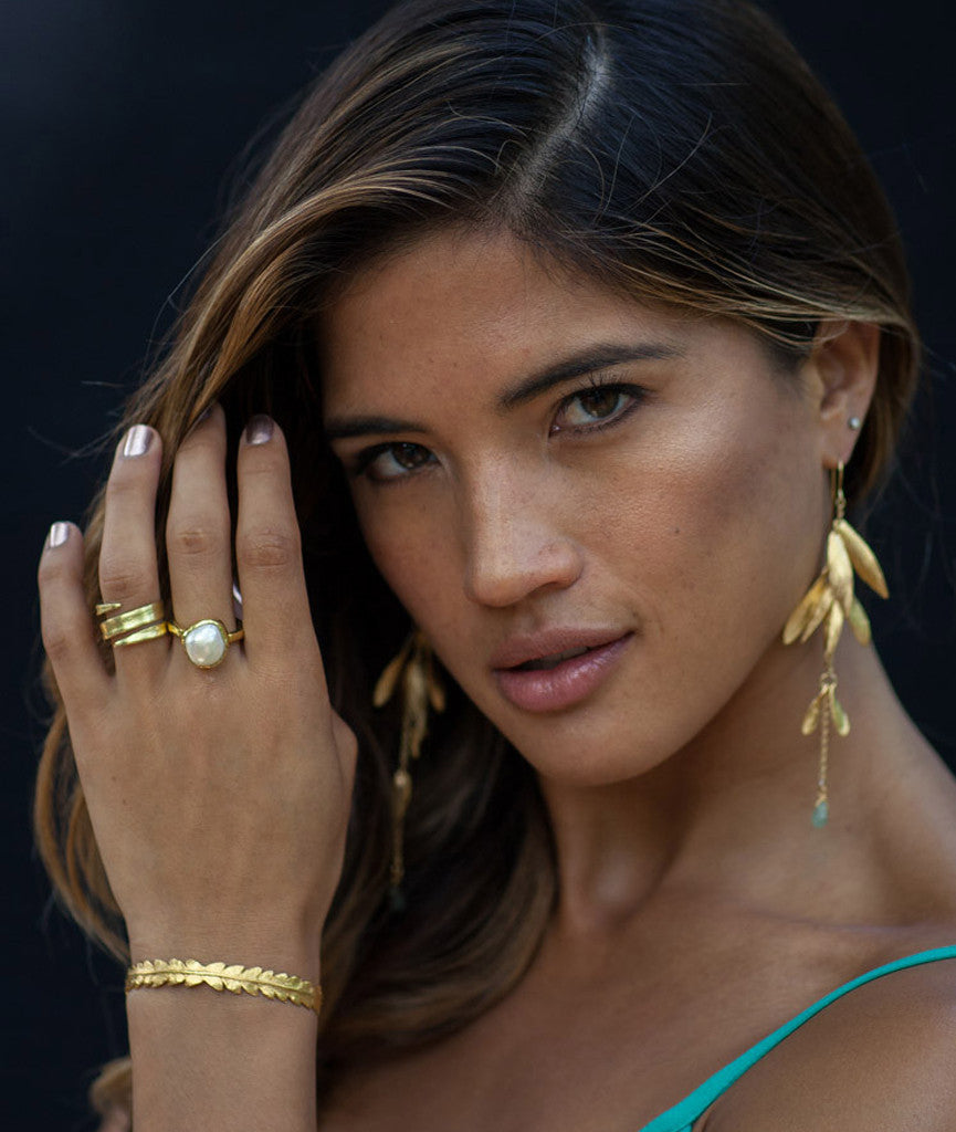 Rocky Barnes wears Catherine Zoraida Gold Long Luck Earrings