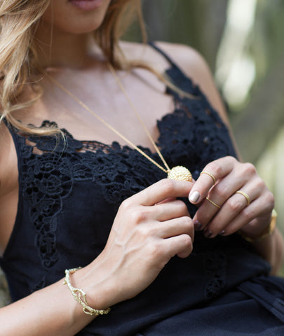 Gold plated silver Lychee Pendant by British Jewellery Designer Catherine Zoraida. Modelled by Rocky Barnes