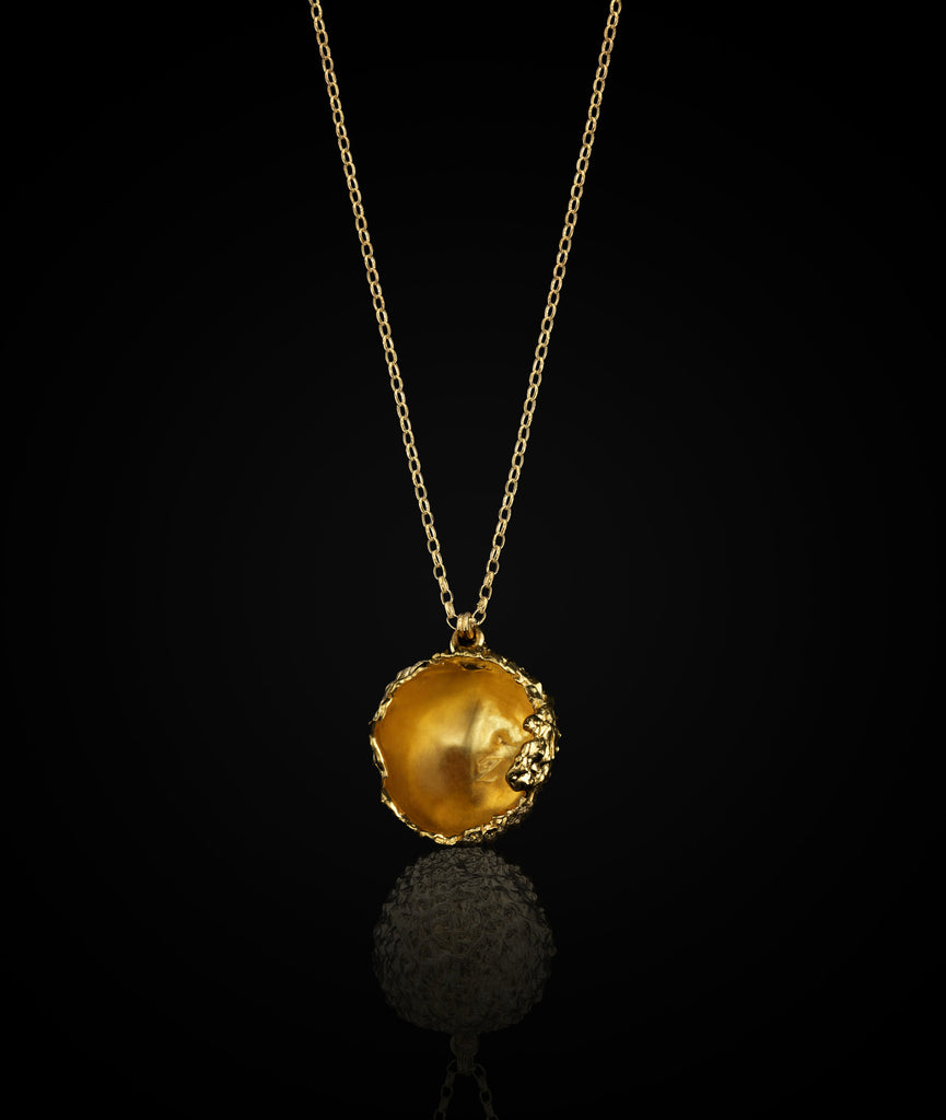 Inside of the Gold plated necklace cast from a real Lychee. A unique design by Catherine Zoraida jewellery