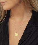 Scorpio Zodiac star sign pendant in gold with silver chain. Model Lucy Williams