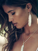 Rocky Barnes wears Catherine Zoraida Silver Feather Earring