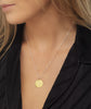 Taurus Zodiac star sign pendant in gold with silver chain. Model Lucy Williams