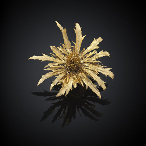 Top view of the gold thistle ring and brooch by Catherine Zoraida