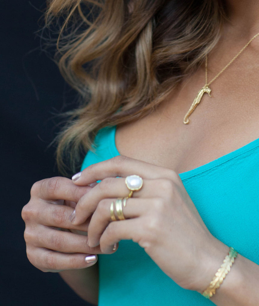 Gold Blade of Grass Ring by Catherine Zoraida. Modelled by Rocky Barnes