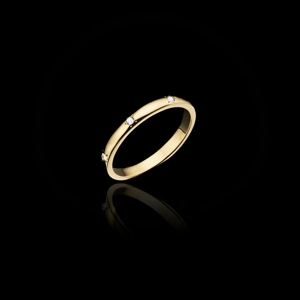 gold and diamond set wedding band by jewellery designer catherine zoraida