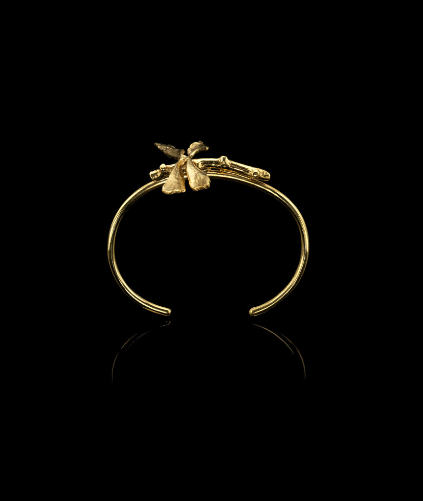 Side profile of the 18 carat gold plated Dragonfly Cuff by British Jewellery designer Catherine Zoraida. Organic and natural.