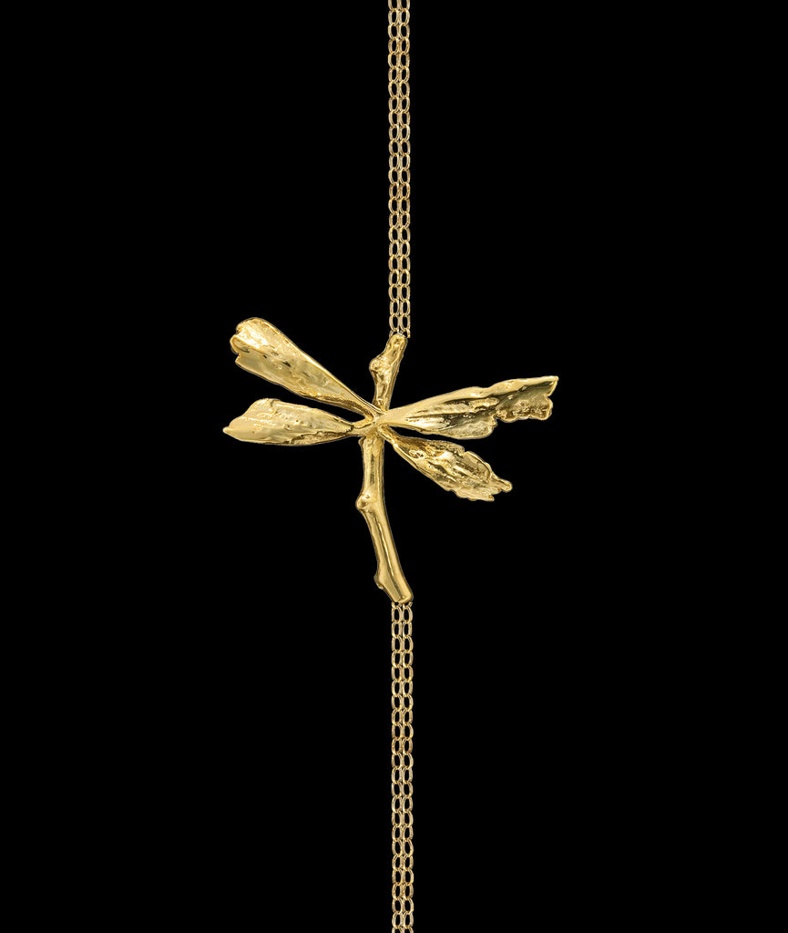 A 18 carat gold plated silver Dragonfly Bracelet on gold chain designed by British designer Catherine Zoraida