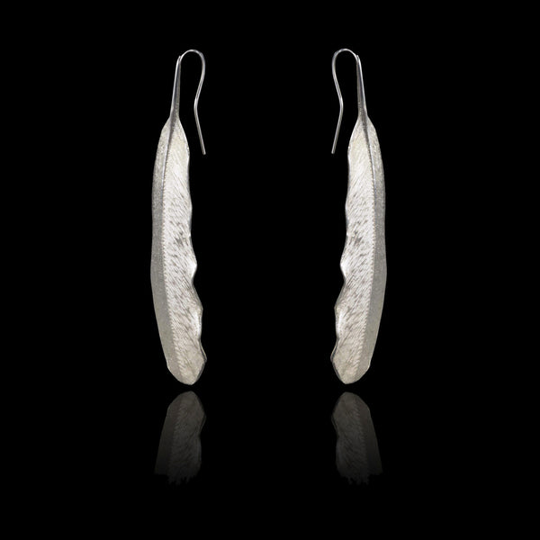 Side view of solid sterling silver Feather Pendant Earrings by British jewellery designer Catherine Zoraida