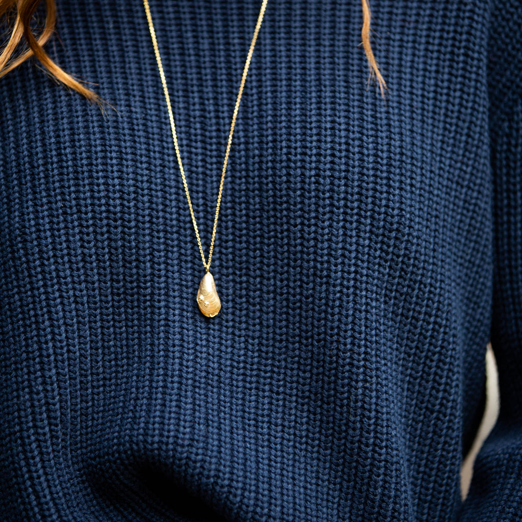 gold mussel shell Pendant by british jewellery designer catherine zoraida