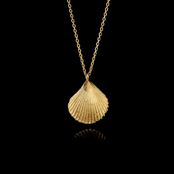 gold shell pendant by british jewellery designer catherine zoraida