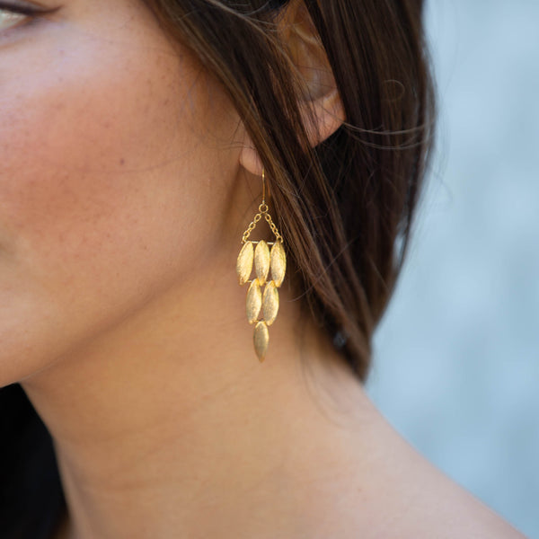gold wing earrings by british jewellery designer catherine zoraida