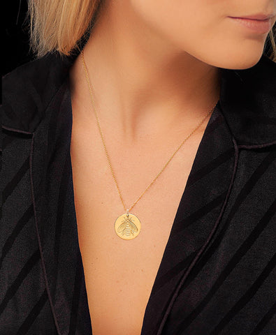 Honeybee disc design necklace worn by blogger Lucy Williams.