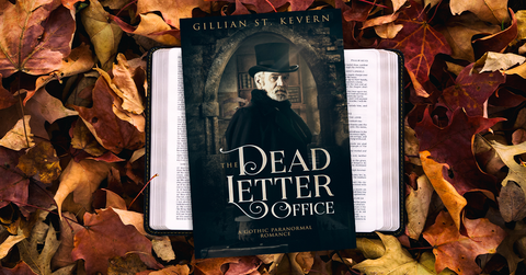 The Dead Letter Office in paperback format, resting on a bed of autumn leaves.