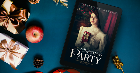 The Christmas Party on an e-reader, laying on a blue surface with apples and Christmas parcels and decorations scattered around.