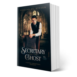 The Secretary and the Ghost cover, a gay gothic romance: A handsome young man in Victorian garb rests against the back of a chair, looking pensively into the distance. In the background, a full moon breaks through the windows of a library, complete with candles and books.