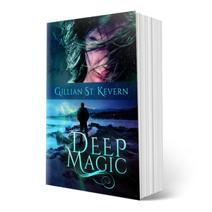 Cover of Deep Magic, a gay romance with mythological elements: The cover is divided in two halves. The top half features a dark haired man smiling enigmatically, his hair swept across his face. The bottom half features a man in silhouette, standing on the rocky Welsh coast, a wave splashing up before him.
