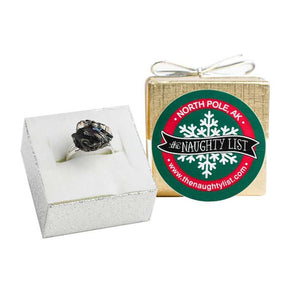 Christmas Coal Ring in a Gold Ring Box by The Naughty List.
