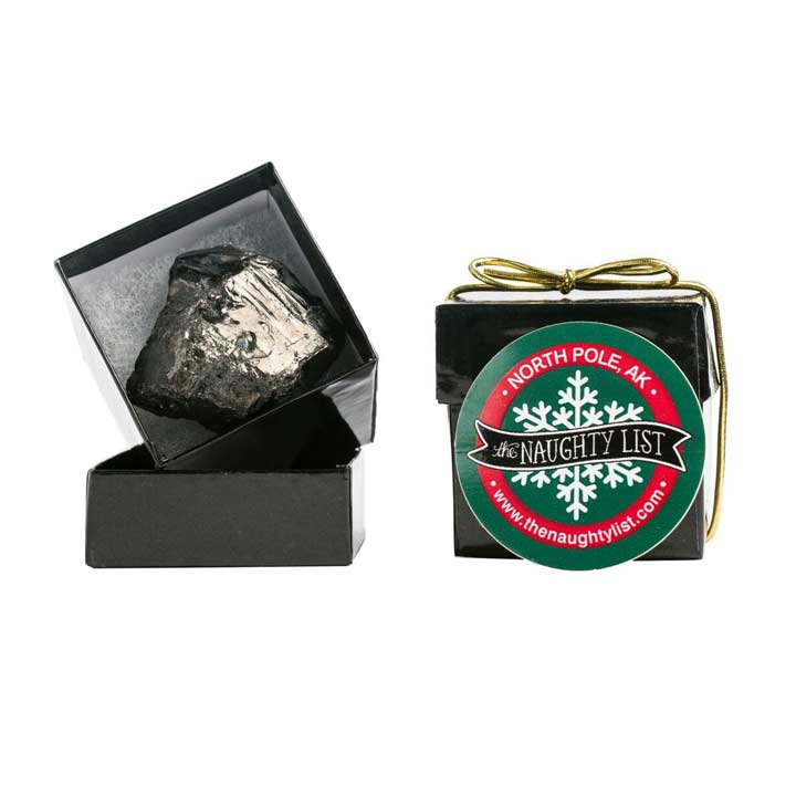 Christmas coal lump in a black ring box by The Naughty List.