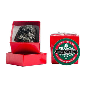Christmas coal lump in a red ring box by The Naughty List.