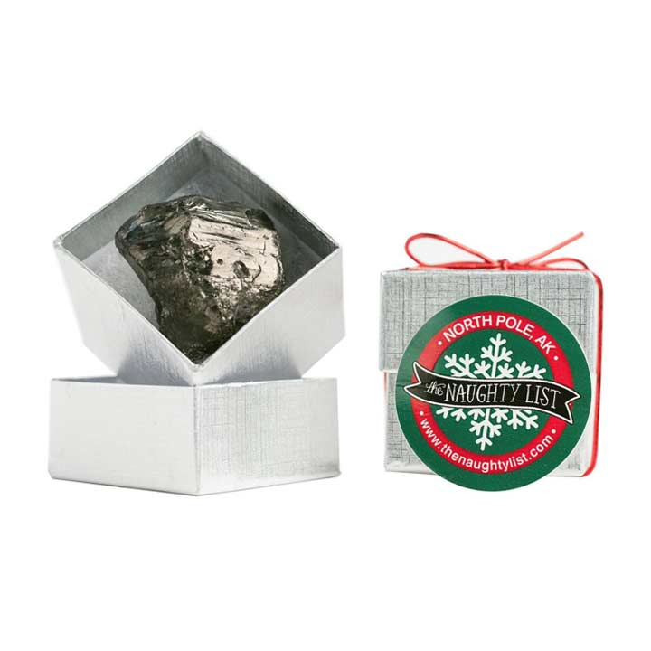 Christmas coal lump in a silver ring box by The Naughty List.