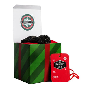 "Large lump of coal in the ""Mistletoe"" packaging from The Naughty List"