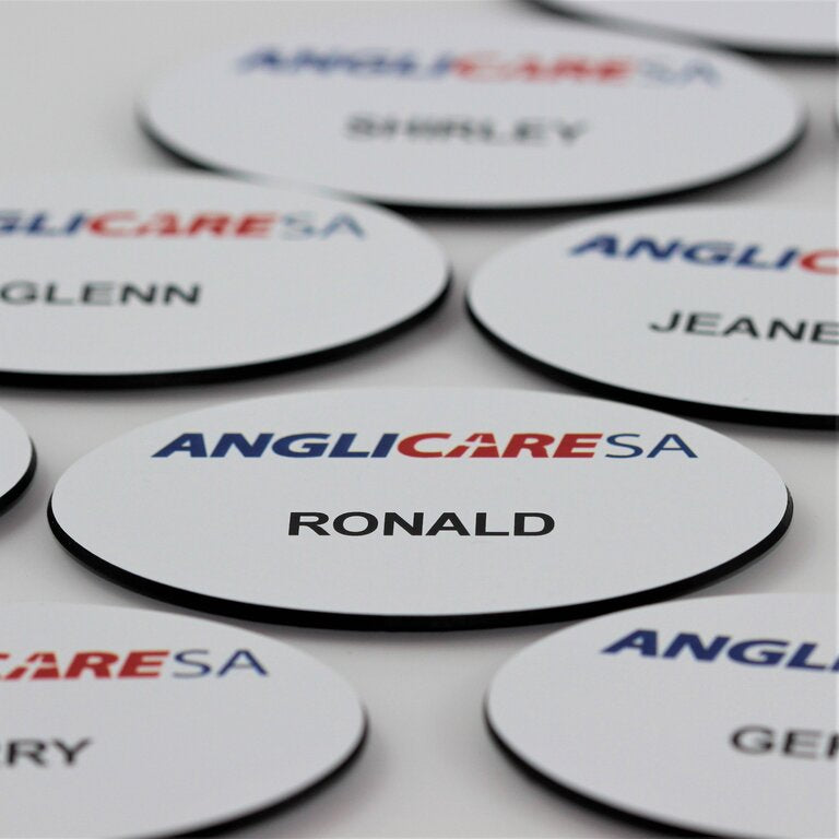Premium oval shaped name badge, white plastic with black back