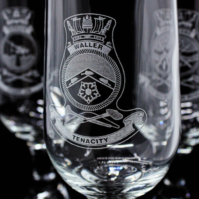 Laser engraved logo on a curved glass surface for personalised gift glasses