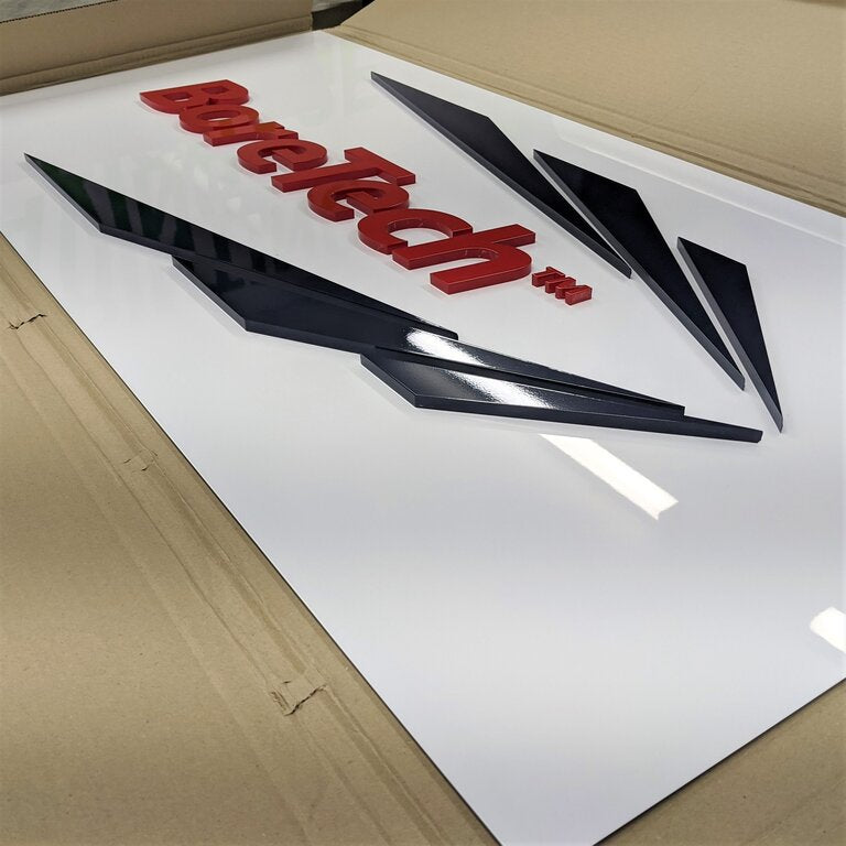 Raised acrylic sign on ACM for company wall signage