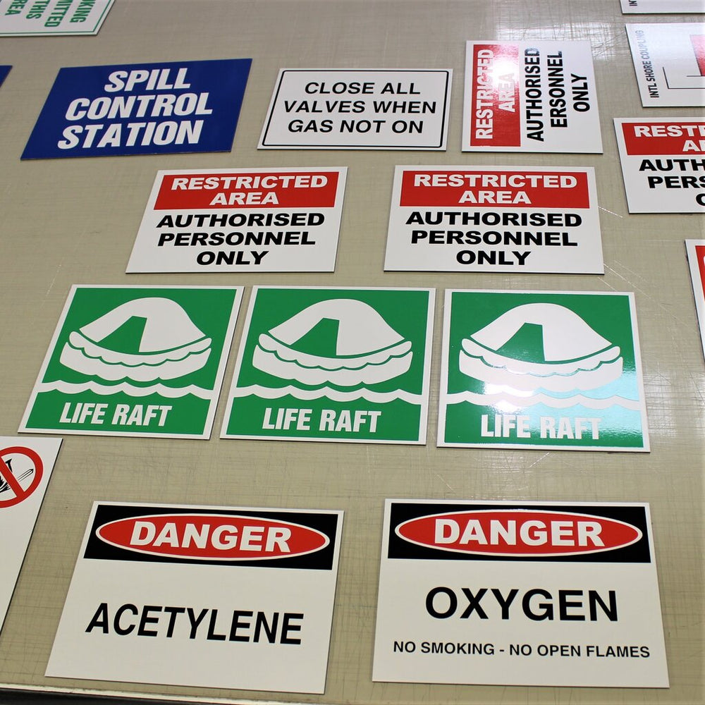 Safety signs for restricted areas and warnings, coloured vinyl on ACM