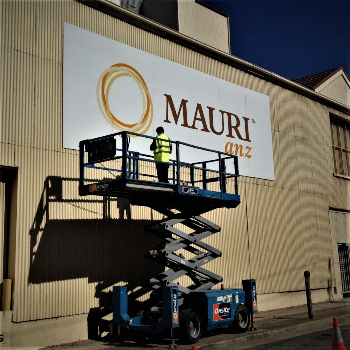 Large ACM Sign instalation on the side of an Adelaide company building