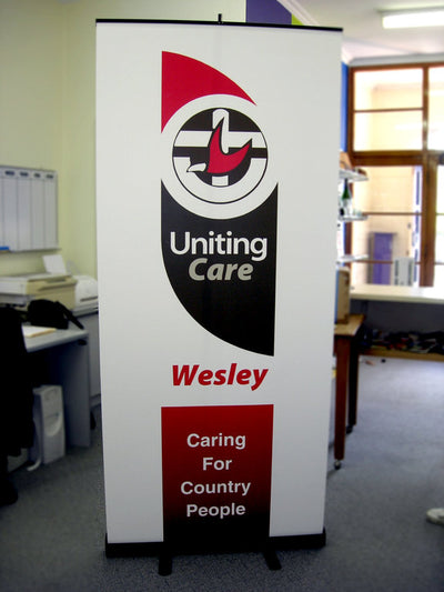 Portable pull up banner stand with sign 2 meters high by 85cm wide, colapses into small base for storage