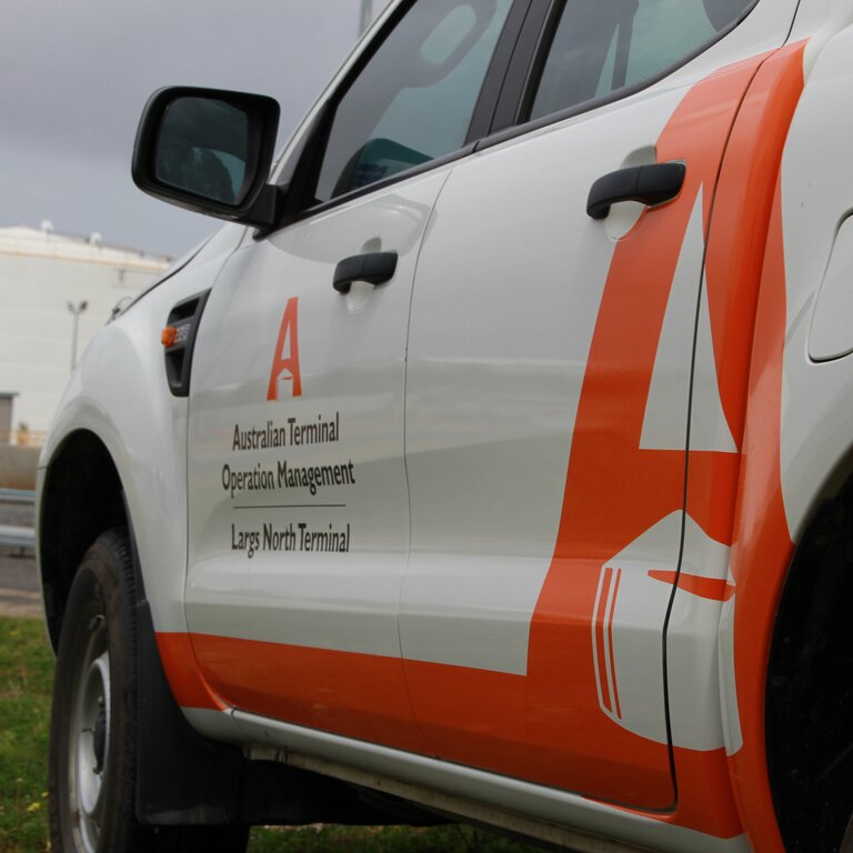 Car stickers on side panel and vehicle doors, bright orange decals for visibility
