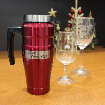 Travel mug with laser engraved text on curved surface, engraved wine glasses with company logos for christmas gifts
