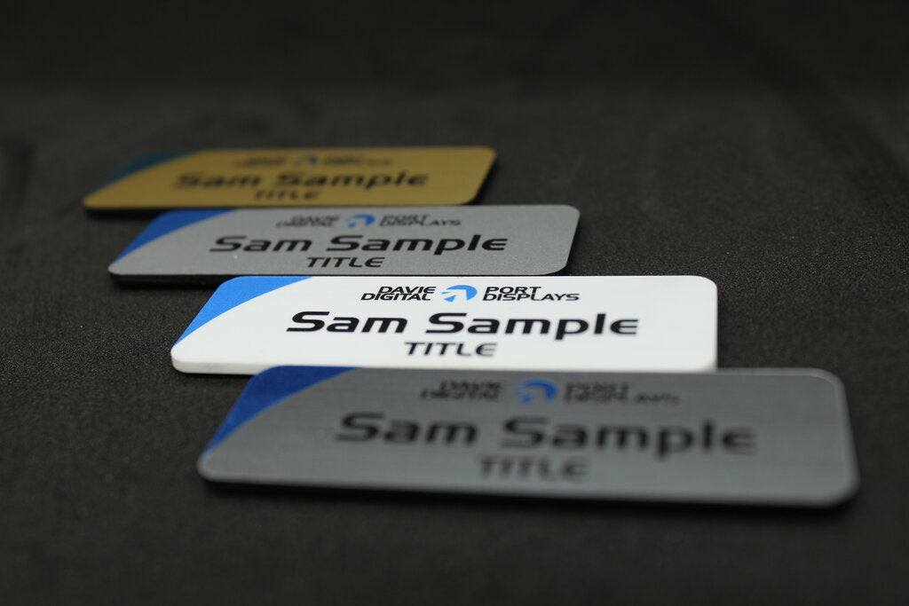 Small name badges in gold white or silver, custom designs with your name, title and logo