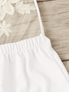 White embroidered plunge halter neck swimsuit