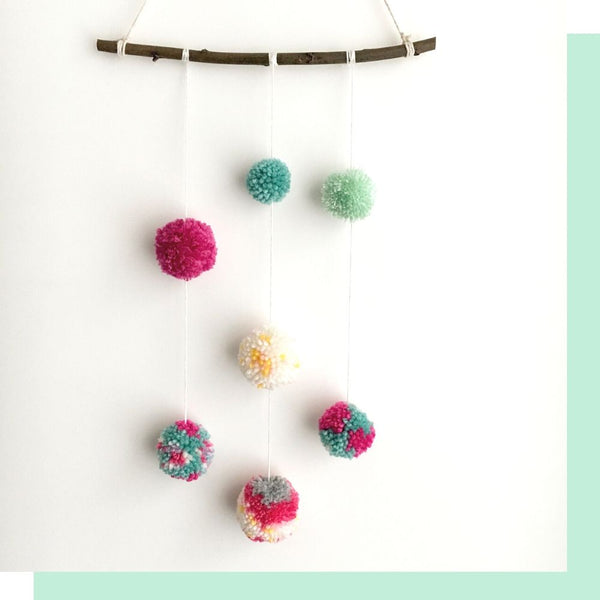 how to make a pom pom wall hanging