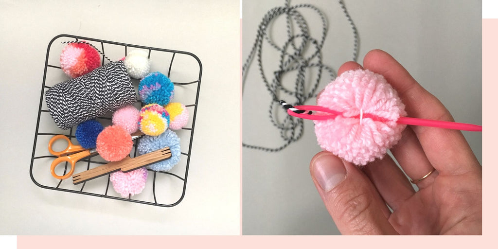 threading darning needle through pom poms