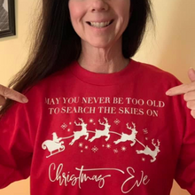 Load image into Gallery viewer, Never too old to search the skies on Christmas Eve red long sleeve tee