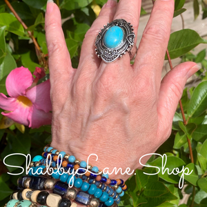 Turquoise stretch ring .