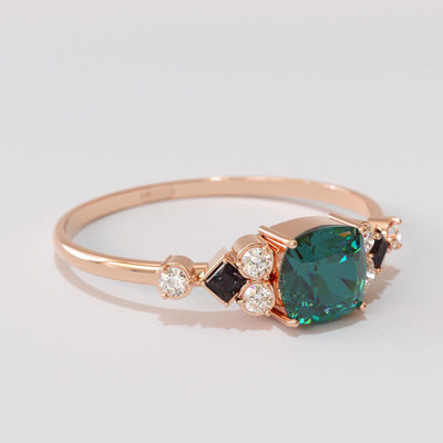 Emerald and black diamond ring