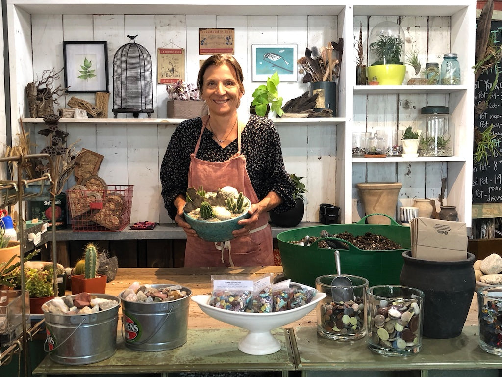 Cristina from Potted behind the Potting Bar holding planted cactus / succulent bowl.