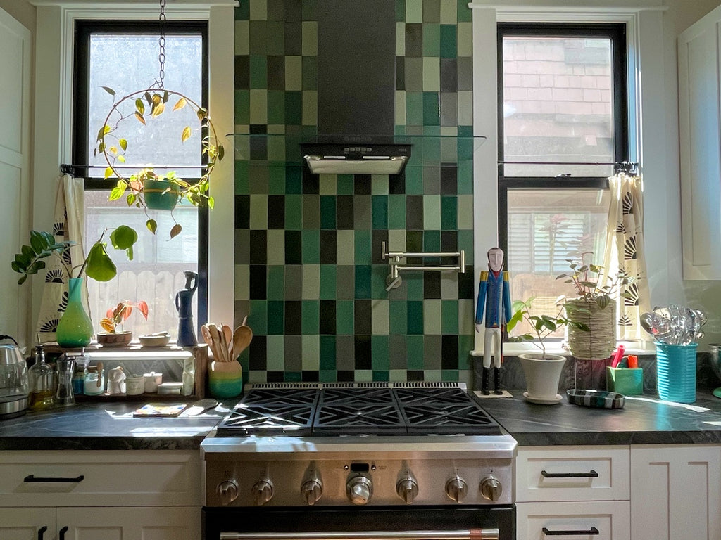 Kitchen featuring Heath Tile and decorating with houseplants.