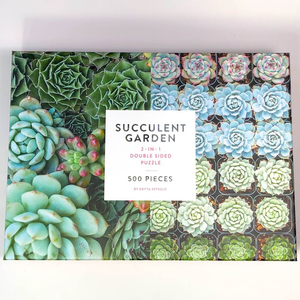 Box showing a 500 piece succulent garden puzzle.