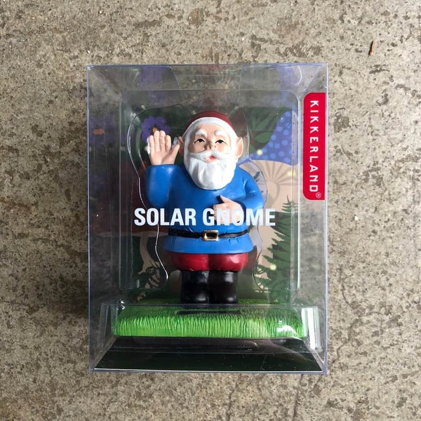 Cute plastic waving gnome powdered by solar with blue shirt.